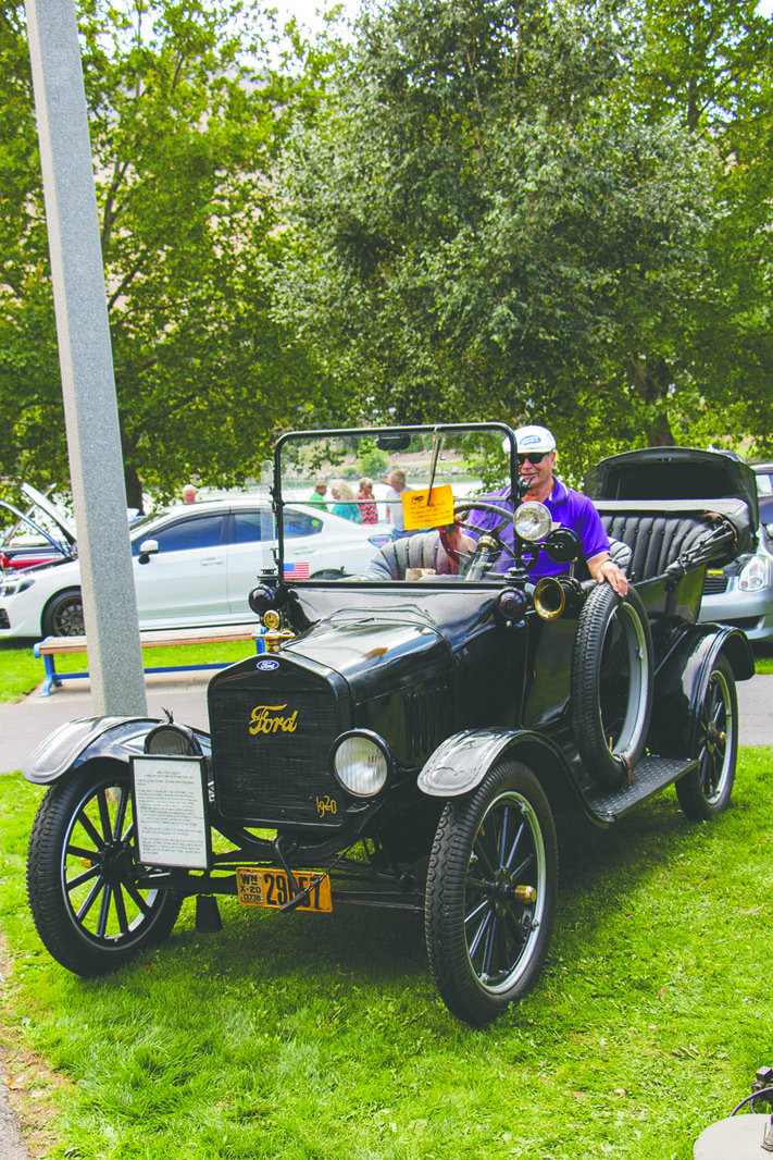 Photos by Erin Rossell, Owner of the 1920 Ford Model T, Robert Bettis of Chelan, starts up the almost century old vehicle, filling the park with the sound of style.
