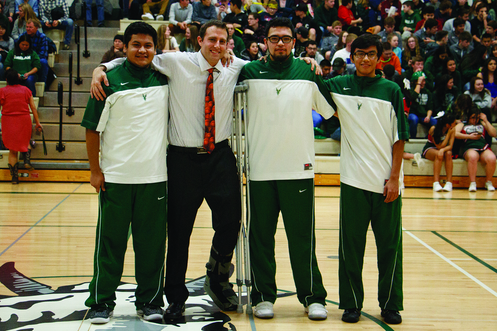 Goats boys' varsity basketball seniors (left to right) Jose Torres, Santiago Jimenez, Miguel Rojas, with Head Coach Jeff Pearl (second from left).