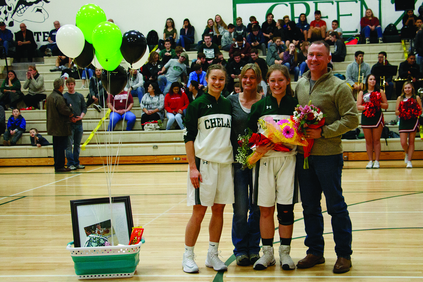Goats girls' varsity basketball senior Ashley Oswald (third in) with sister Molly Oswald (left), mom Fran Oswald (second from left) and dad Eric Oswald (right).