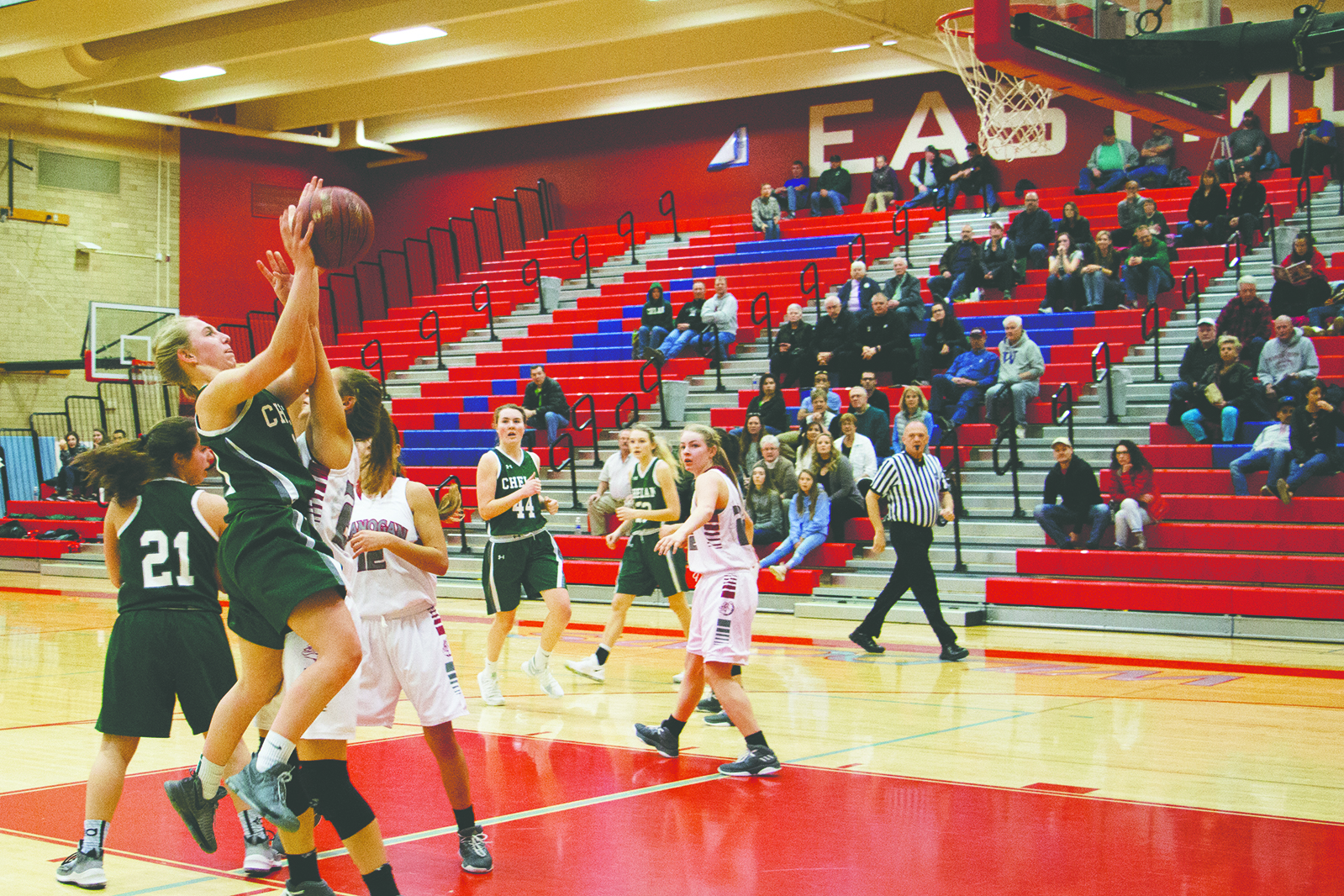Booh Huddleston soars inside the key for a Lady Goats basket against the Okanogan Bulldogs. Okanogan defeated Chelan in the final minutes of the game, with a final score of 41-50.