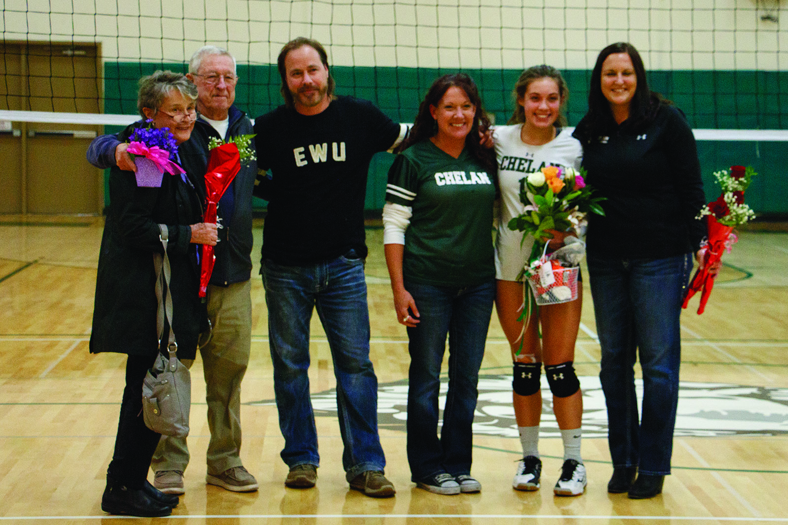 Ava Dickes stands with grandparents (left), parents (right), and Head Coach Jenifer Rainville (right).